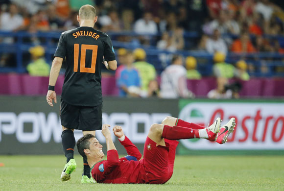 Portugal's Cristiano Ronaldo celebrates in front of Netherlands' Wesley Sneijder after winning the Group B Euro 2012 match at Metalist stadium in Kharkiv