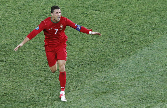 Portugal's Cristiano Ronaldo celebrates after scoring his second goal against Netherlands during their Group B match at the Metalist stadium in Kharkiv