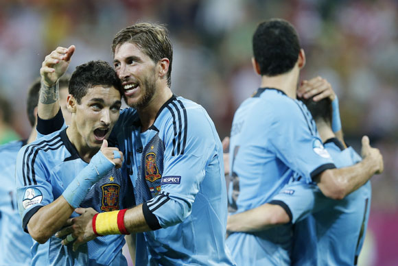 Spain's Jesus Navas (L) celebrates with his team mate Sergio Ramos after scoring a goal against Croatia during their Group C match at the PGE Arena in Gdansk