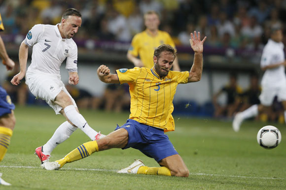 France's Franck Ribery (L) tackles Sweden's Olof Mellberg during their Group D match at the Olympic Stadium in Kiev