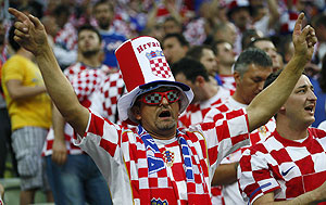 A fan of Croatia cheers