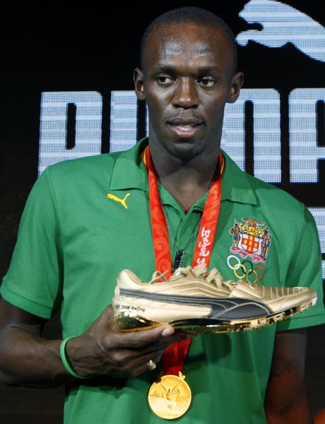 Usain Bolt shows his Puma shoes