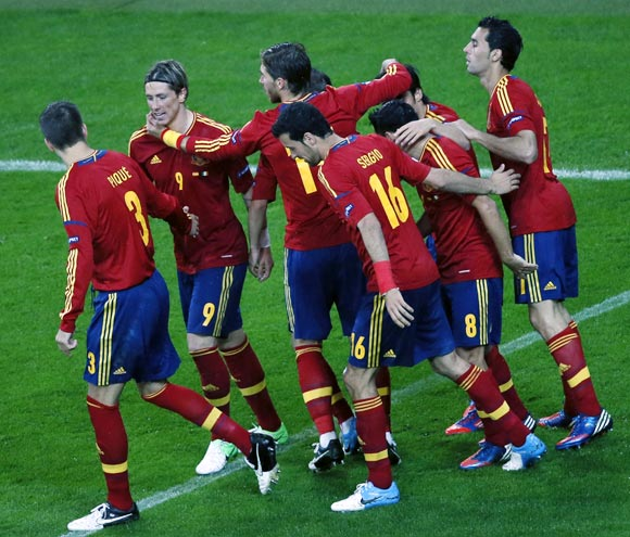 The Spanish players celebrate