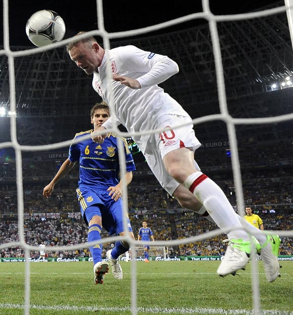 England's Wayne Rooney scores a goal against Ukraine