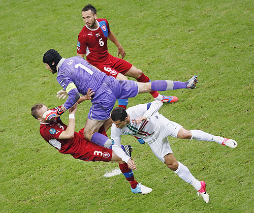 Portugal's Cristiano Ronaldo (centre) battles for the ball with Czech Republic's Tomas Sivok (right), Michal Kadlec (left) and goalkeeper Petr Cech
