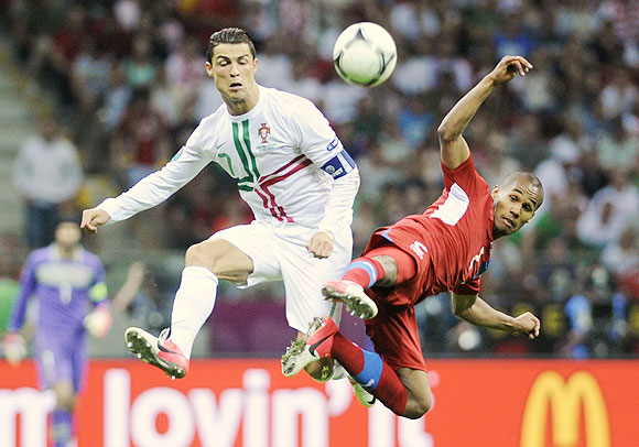 Portugal's Cristiano Ronaldo (right) and Czech Republic's Theodor Gebre Selassie fight for the ball