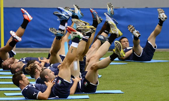 Italy's players stretch during a training session