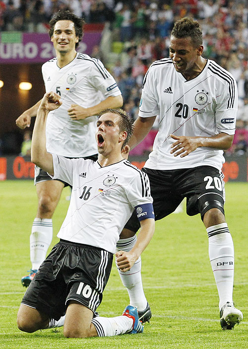 Germany's Philipp Lahm (centre) celebrates with team-mates Mats Hummels (left) and Jerome Boateng