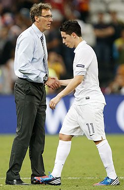 France's coach Laurent Blanc (left) shakes hands with Samir Nasri after their loss against Spain on Saturday