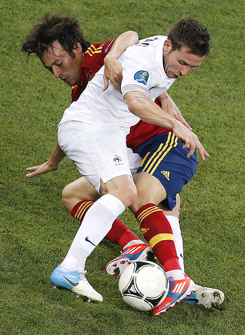 Spain's David Silva (left) challenges France's Yohan Cabaye