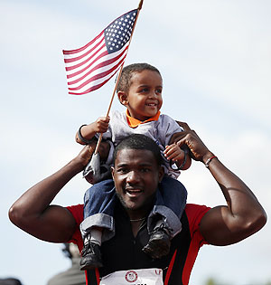 Justin Gatlin celebrates with his son Jace after winning the men's 100 meter final at the US Olympic athletics trials in Eugene, Oregon on Sunday