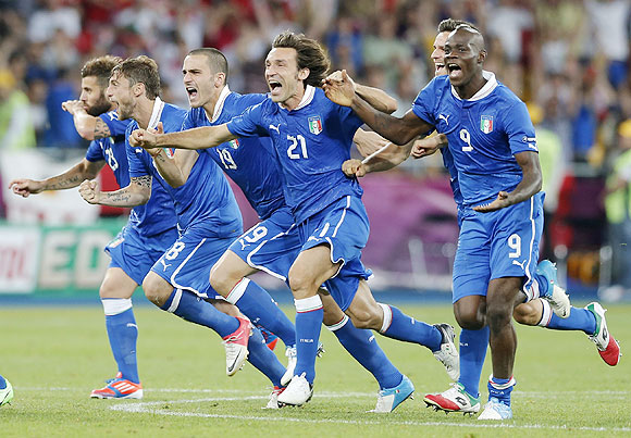 Italy's players celebrate after defeating England in penalty shoot-outs in the Euro quarter-final