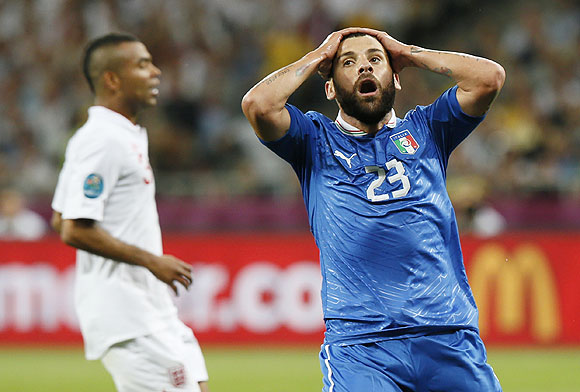 Italy's Antonio Nocerino (right) reacts after missing a scoring opportunity
