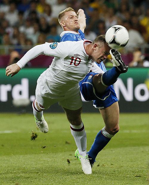 Italy's Ignazio Abate (left) challenges England's Wayne Rooney
