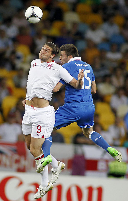 England's Andy Carroll (left) and Italy's Andrea Barzagli are involved in an aeriel battle for possession