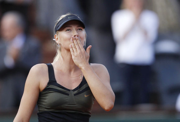 Sharapova comes back down to earth at Wimbledon