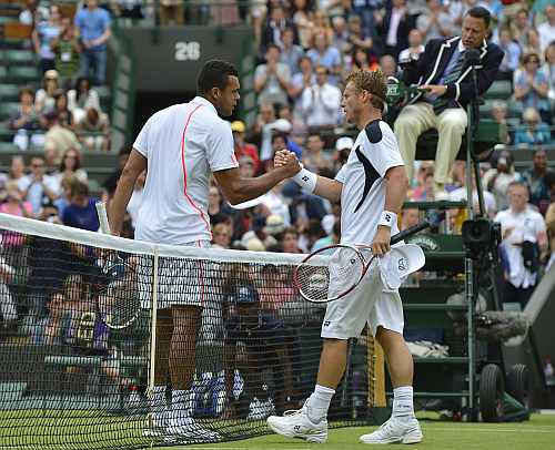 Jo-Wilfried Tsonga of France shakes hands with Lleyton Hewitt of Australia after defeating him in their men's singles tennis match at the Wimbledon tennis championships in London