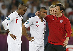 England's assistant coach Gary Neville (right) comforts England's Ashley Cole (2nd from left) and Ashley Young (left)