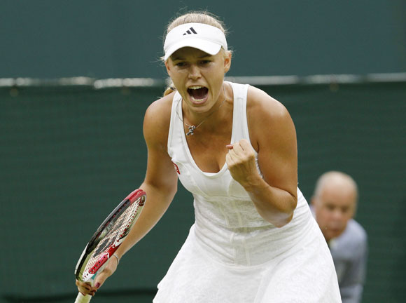 Caroline Wozniacki of Denmark reacts during her women's singles tennis match against Tamira Paszek of Austria at the Wimbledon tennis championships in London