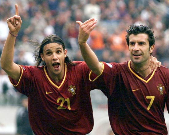 Portugal's Nuno Gomes (left) with Luis Figo
