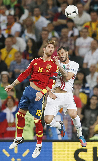 Spain's Sergio Ramos and Portugal's Hugo Almeida (right) in an aeriel challenge