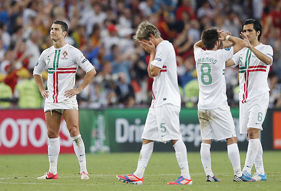 Portugal's Cristiano Ronaldo, Fabio Coentrao, Joao Moutinho and Custodio react after losing to Spain
