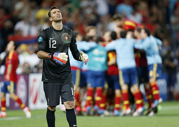 Portugal's goalkeeper Rui Patricio reacts as he failed to make a save at the last shot