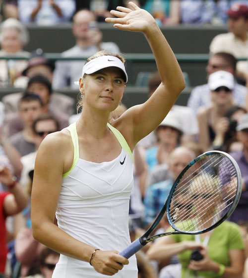 Maria Sharapova of Russia celebrates after defeating Tsvetana Pironkova of Bulgaria in their women's singles tennis match at the Wimbledon tennis championships in London