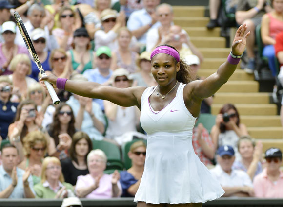 Serena Williams of the U.S. reacts after defeating Melinda Czink of Hungary in their women's singles tennis match at the Wimbledon tennis championships in London