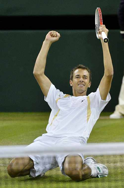 Lukas Rosol celebrates after defeating Rafael Nadal in their men's singles match at the Wimbledon in London