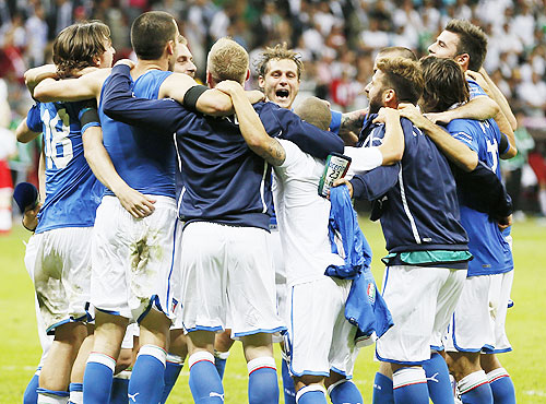 Italy's players celebrate
