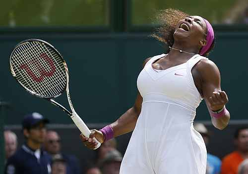 Serena Williams reacts after winning her match against Zheng Jie during their women's singles match at the Wimbledon