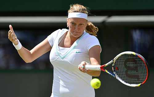 Petra Kvitova hits a return to Varvara Lepchenko during their women's singles match at the Wimbledon