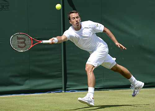 Philipp Kohlschreiber hits a return to Lukas Rosol during their men's singles match at the Wimbledon