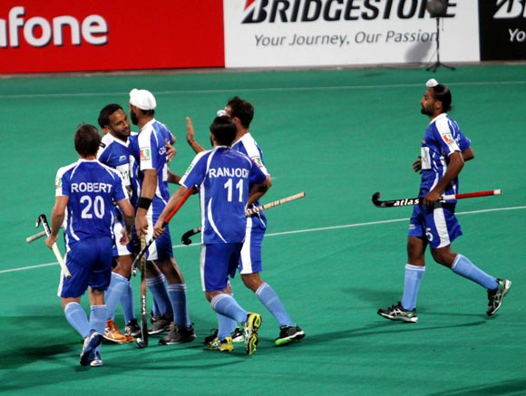 Chandigarh Comets players celebrate after scoring a goal