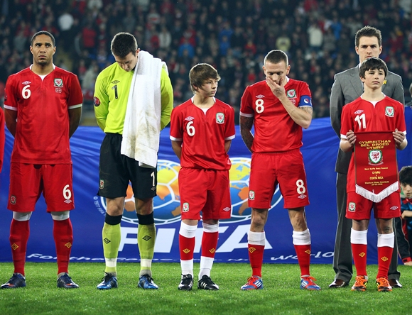 The Wales team lines up with children of the late Gary Speed, Edward and Thomas Speed during the Gary Speed Memorial International Match between Wales and Costa Rica