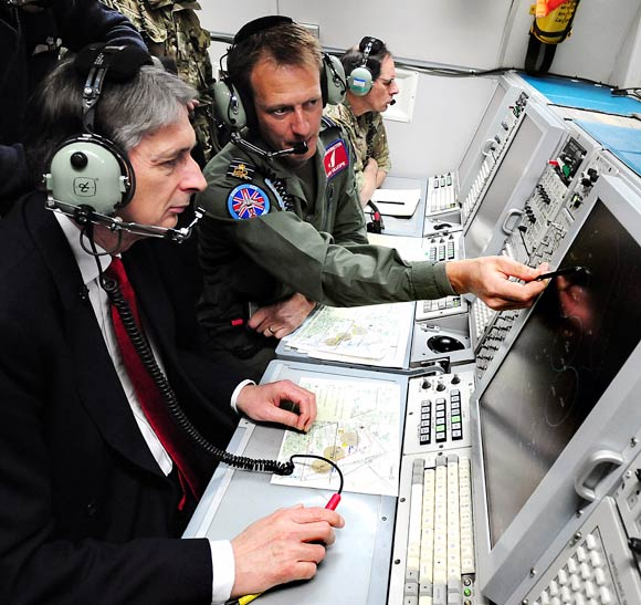 UK's Secretary of State for Defence Philip Hammond observes an Olympic training exercise during a flight on the E-3D Sentry aircraft in Lincoln, England