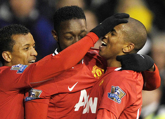 Manchester United's Ashley Young (right) celebrates with teammates after scoring against Tottenham Hotspur on Sunday