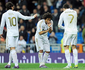 Real Madrid's Cristiano Ronaldo (right) celebrates with Marcelo and Mesut Ozil after scoring the opening goal against Espanyol on Sunday