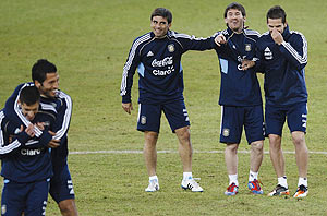 Argentina's Lionel Messi (2nd from right) attends a training session with teammates Rodrigo Brana (3rd from right) and Fernando Gago (right)