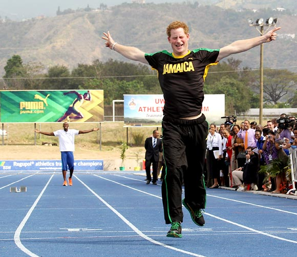 Prince Harry leaves Usain Bolt in his wake as he races him at the Usain Bolt Track at the University of the West Indies in Kingston