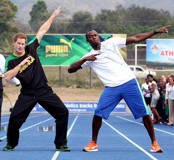 Prince Harry poses with Usain Bolt