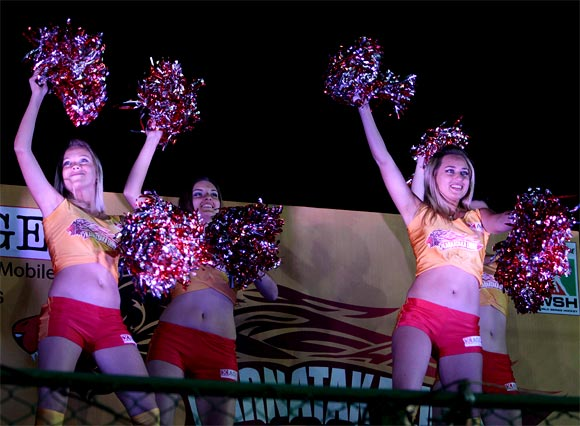 Cheerleaders perform during the match