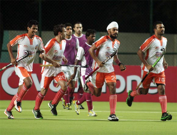 Mumbai Marines players celebrate after scoring