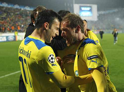 APOEL players celebrate after reaching he quart-finals