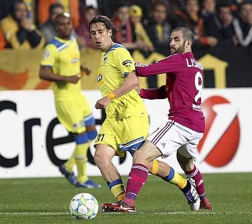 APOEL Nicosia's Helder Sousa challenges Olympique Lyon's Lyon Lisandro