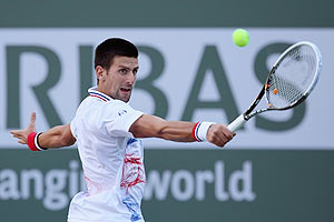 Novak Djokovic of Serbia returns a backhand to Andrey Golubev of Kazakhstan