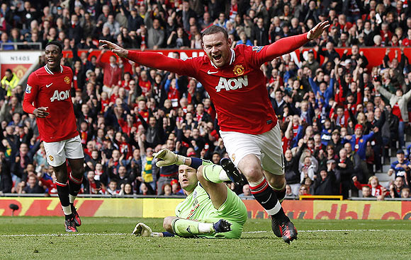Manchester United's Wayne Rooney (right) celebrates after his goal against West Bromwich Albion at Old Trafford on Sunday