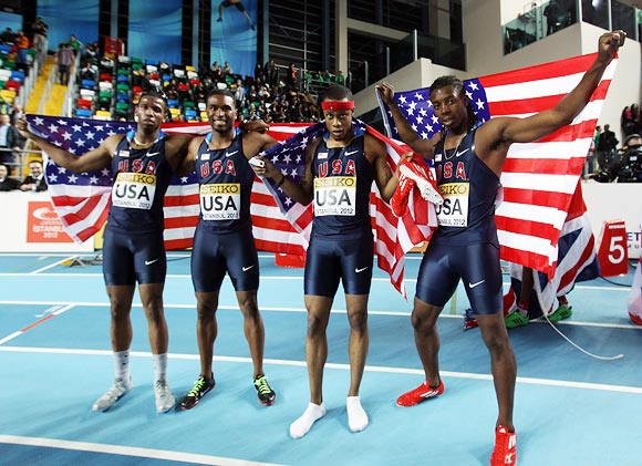 (Left to right): Gil Roberts, Manteo Mitchell, Frankie Wright and Calvin Smith of the US celebrate winning the men's 4 x 400 metres at the 14th IAAF World Indoor Championships