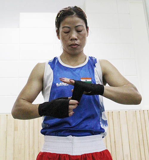 Mary Kom wears her bandages before the sparring session at the Balewadi Sports Complex